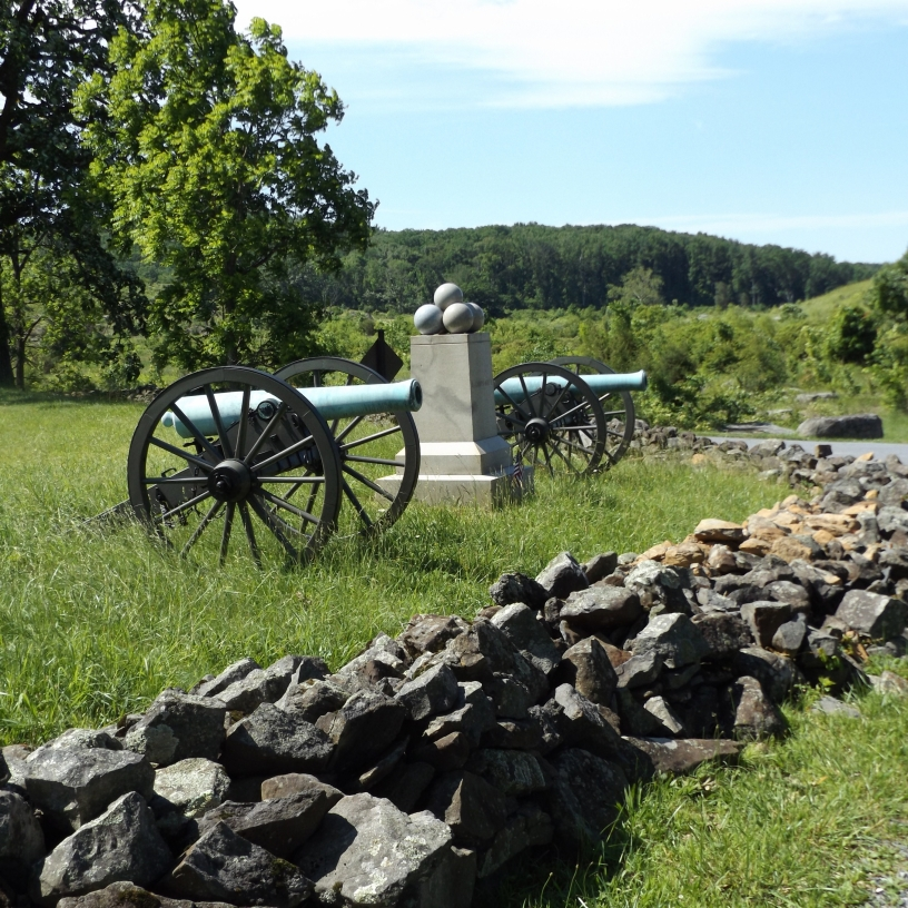 This is the monument to Battery C, 3rd Massachusetts Light Artillery, located at the intersection of Wheatfield Road and Crawford Avenue, on the J. Weikert property.  In the background looms Big Round Top, and, to the right, out of the picture is the area of Devils Den, Houcks Ridge, and The Valley of Death.