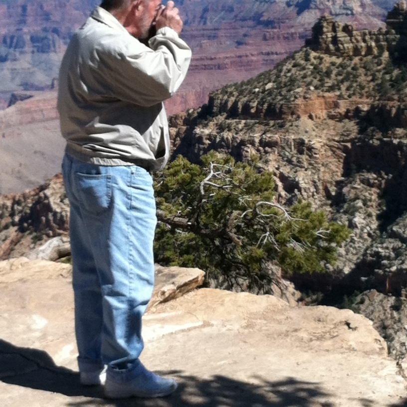 Jim taking a photo at the edge of the Grand Canyon