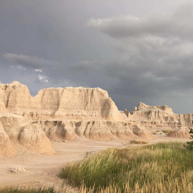 Badlands with storm clouds in the background