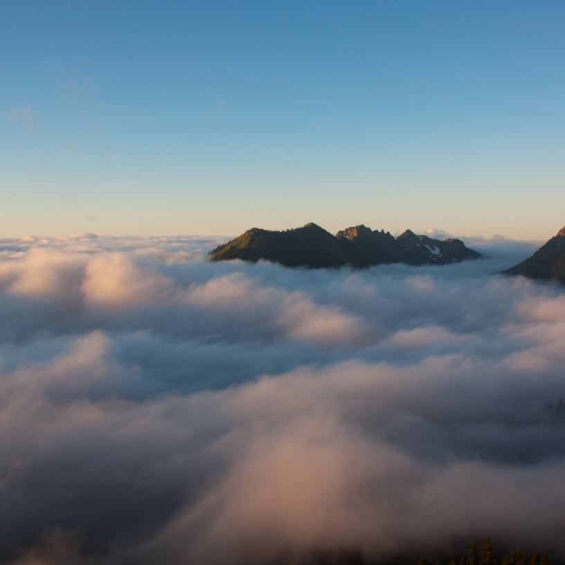 Looking out above the clouds during sunrise on Mt. Rainier.