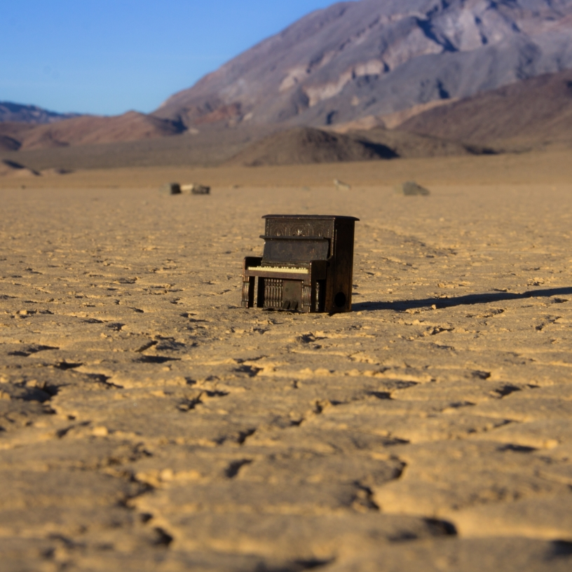 Chris Cander's mini piano among the sailing stones of Racetrack Playa