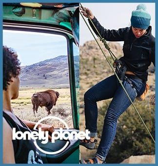 Split image: left shows a person looking out of a car at a buffalo in the distance. The right shows someone looking down as they climb a stone rock face. On top of these: the Lonely Planet logo in white. The entire image is framed in a light blue box.