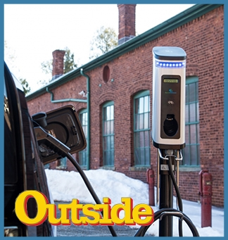 An electric vehicle charges at a charging station in the winter. On top of that image is the Outside logo. The entire image is framed in a light blue box