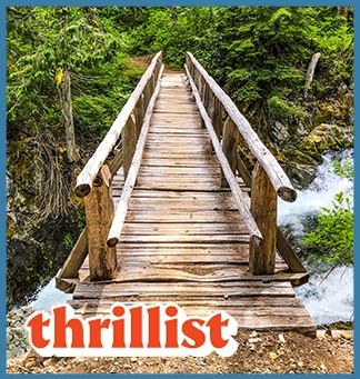 A wooden bridge over a waterfall in Mount Rainier National Park. On top of that image, the Thrillist logo in red and white. A light blue box surrounds the entire image