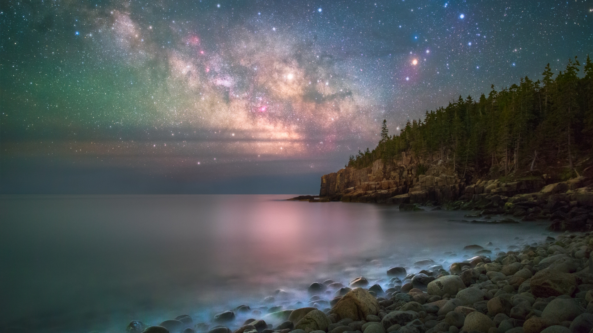 Colorful Milky Way over Boulder Beach at Acadia National Park
