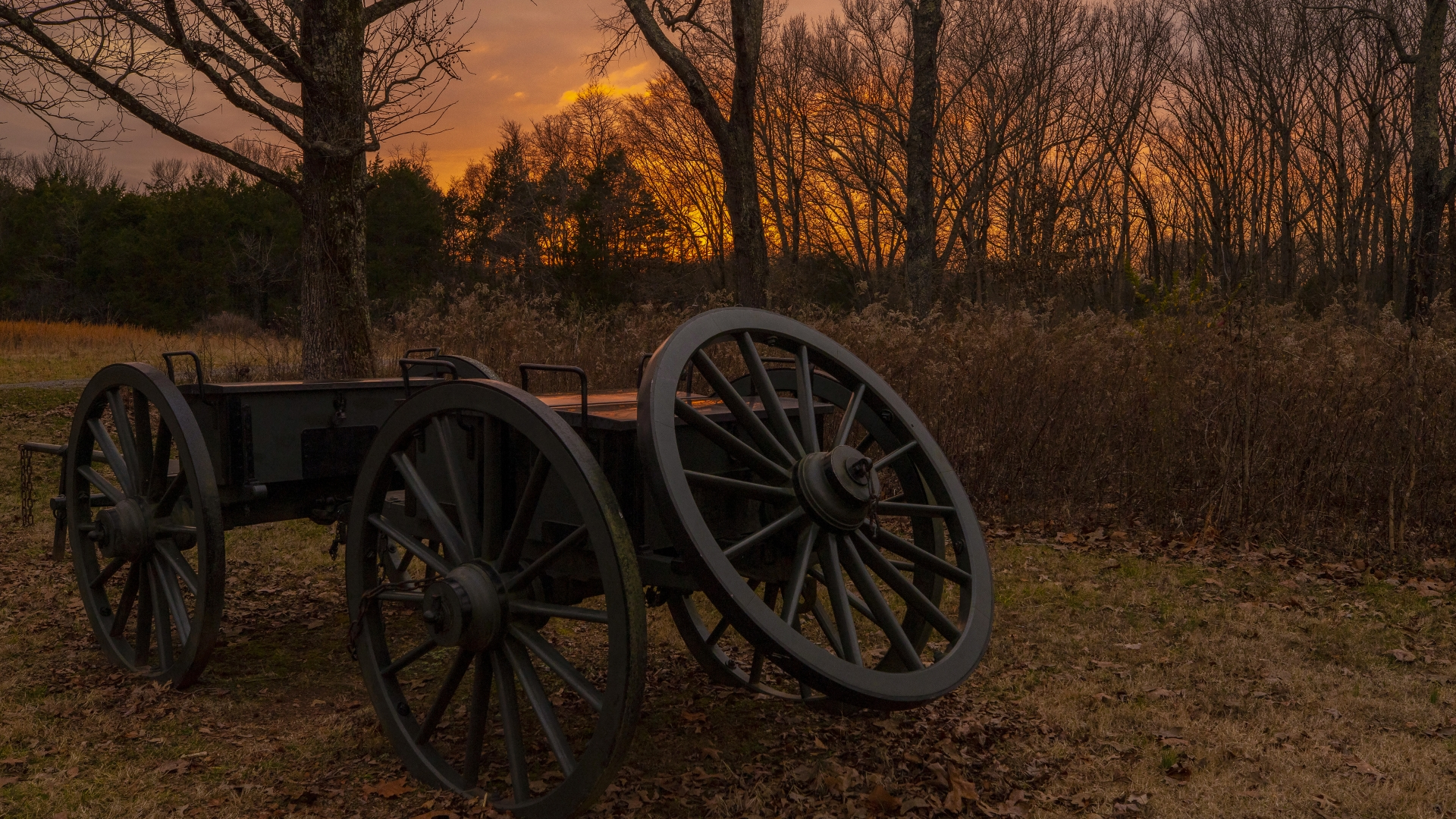 A old cannon on a battlefield at dusk