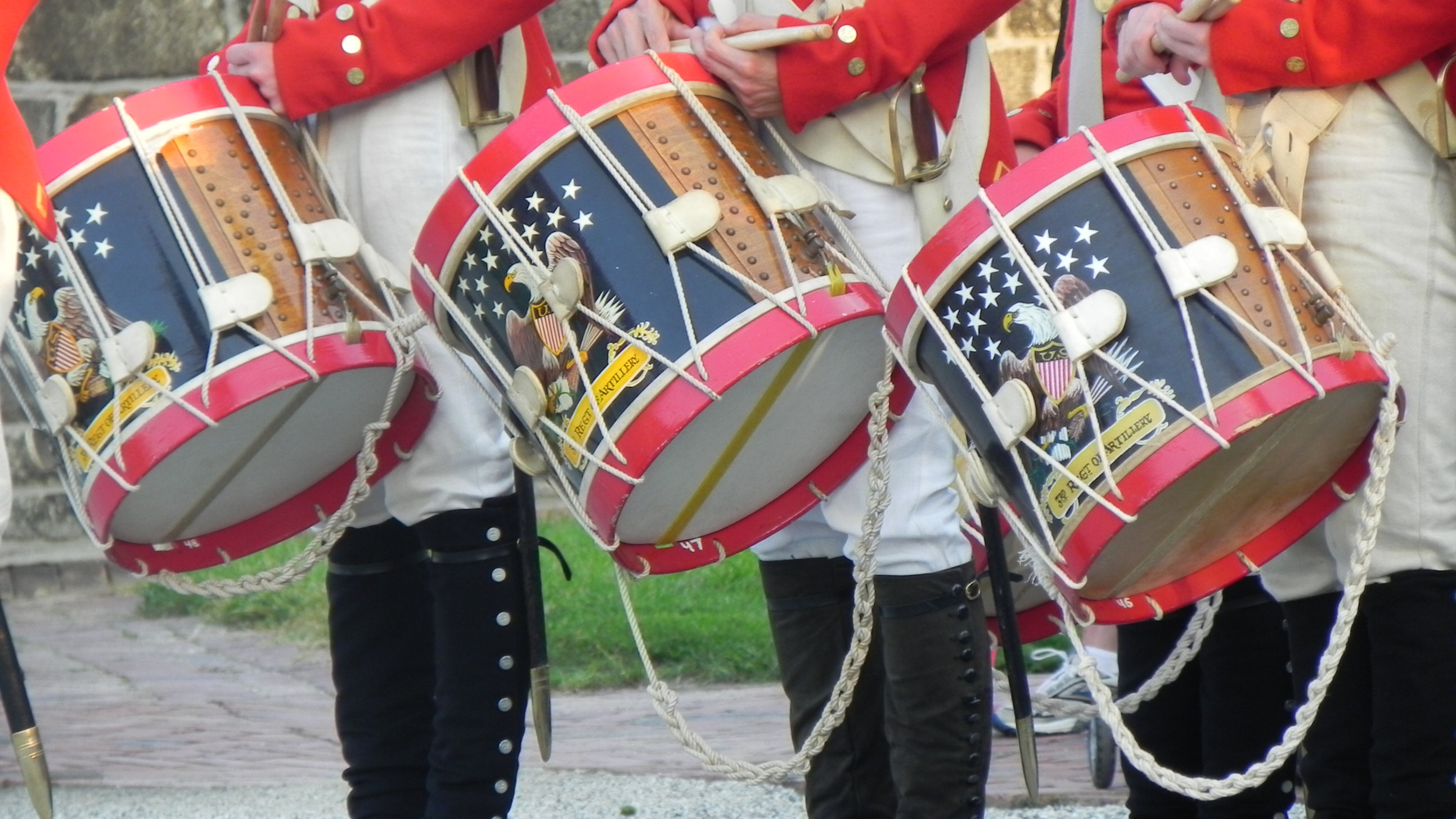 Red, white, and blue snare drums in a line