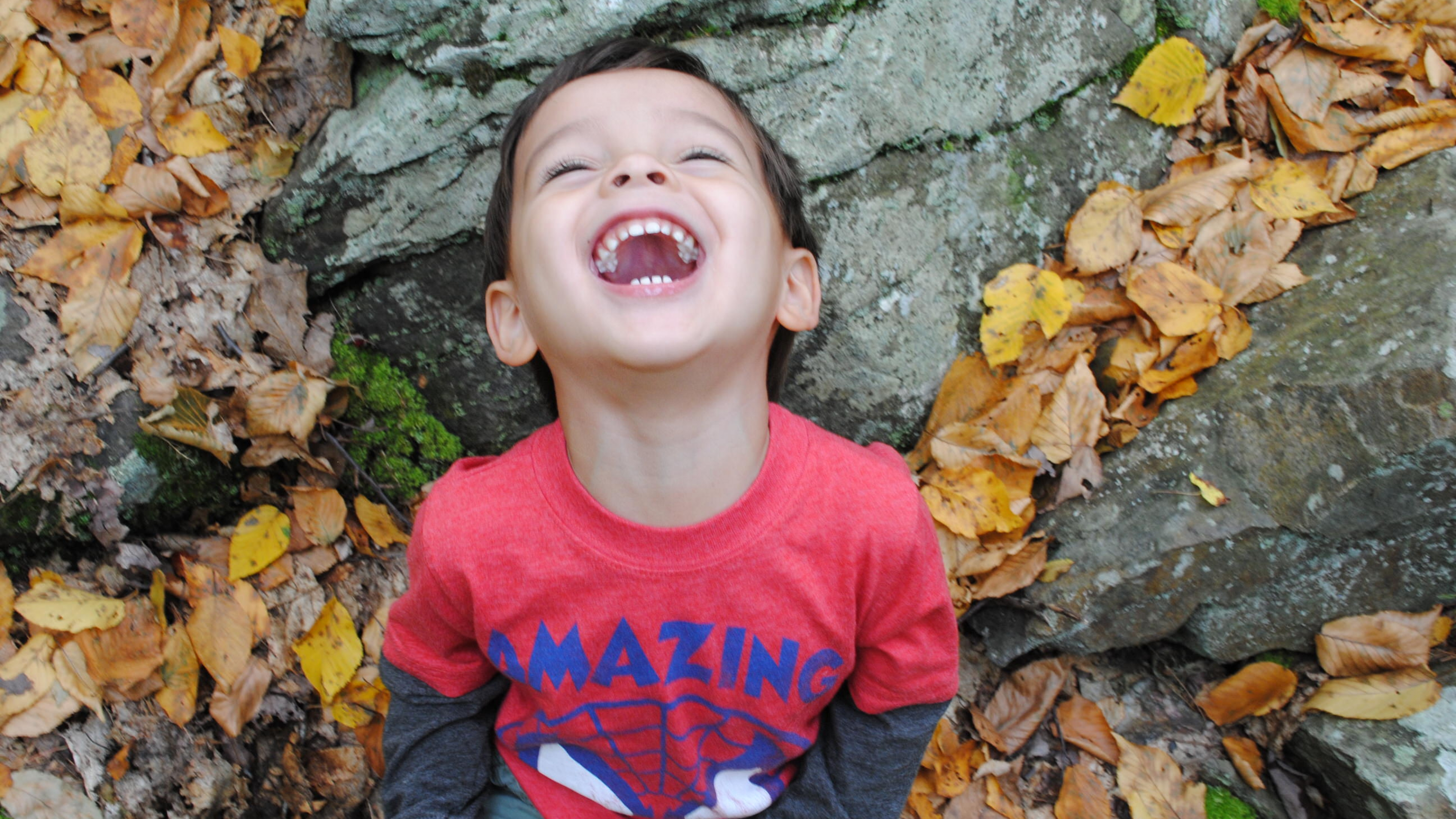 Frank Barrows son laughing in leaves