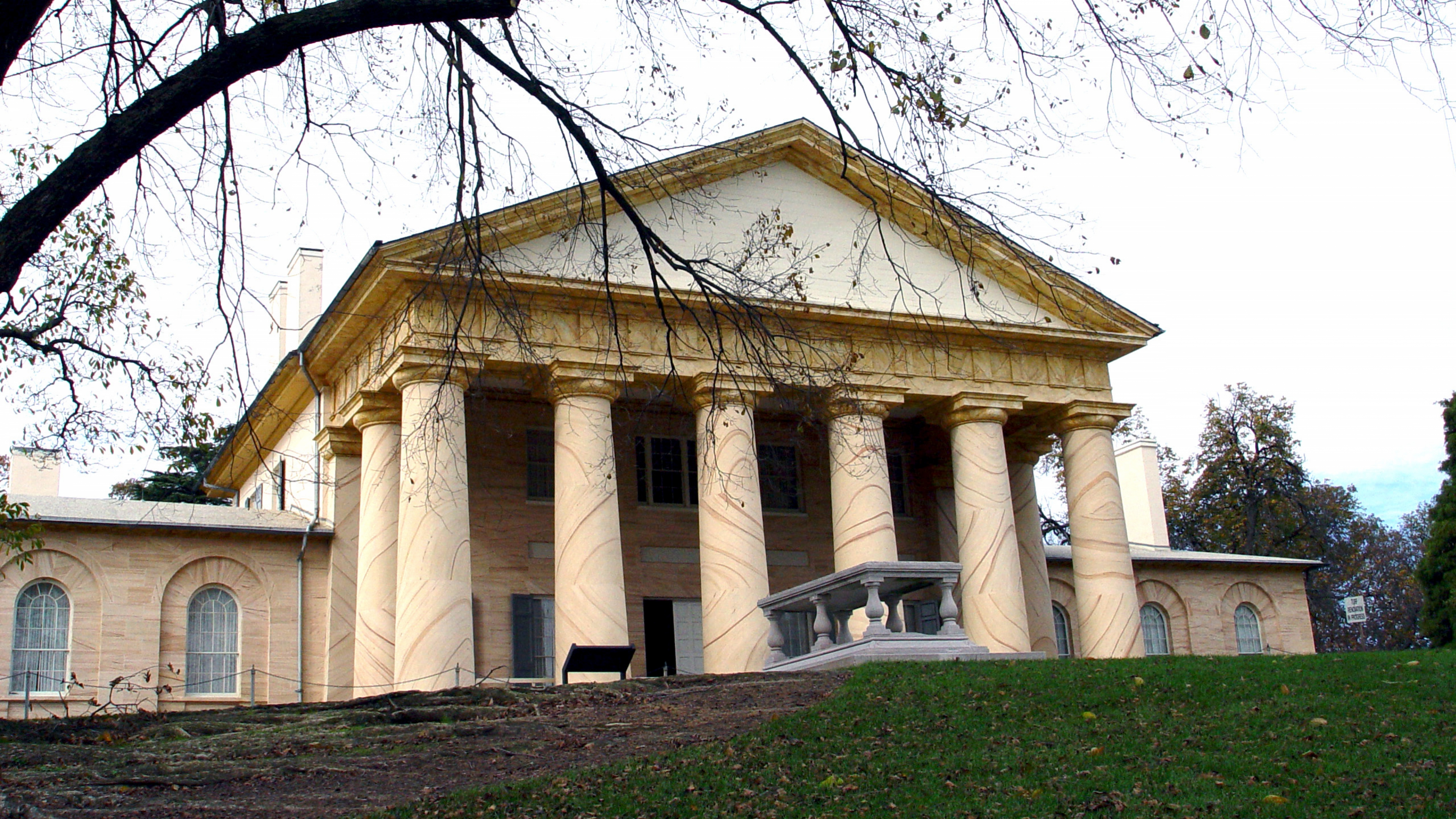 The front of Arlington House viewed through trees