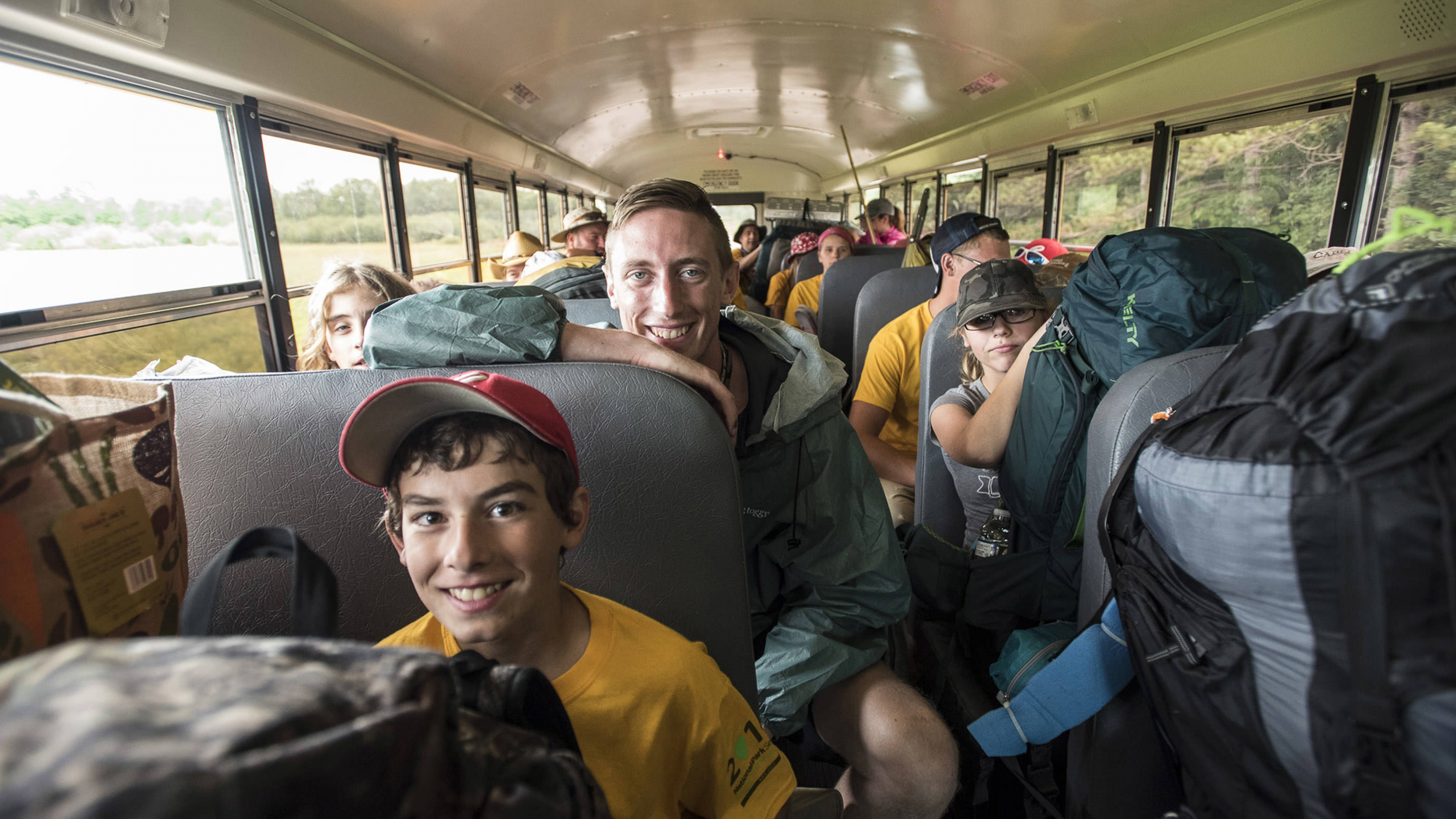 Inside a bus filled with kids