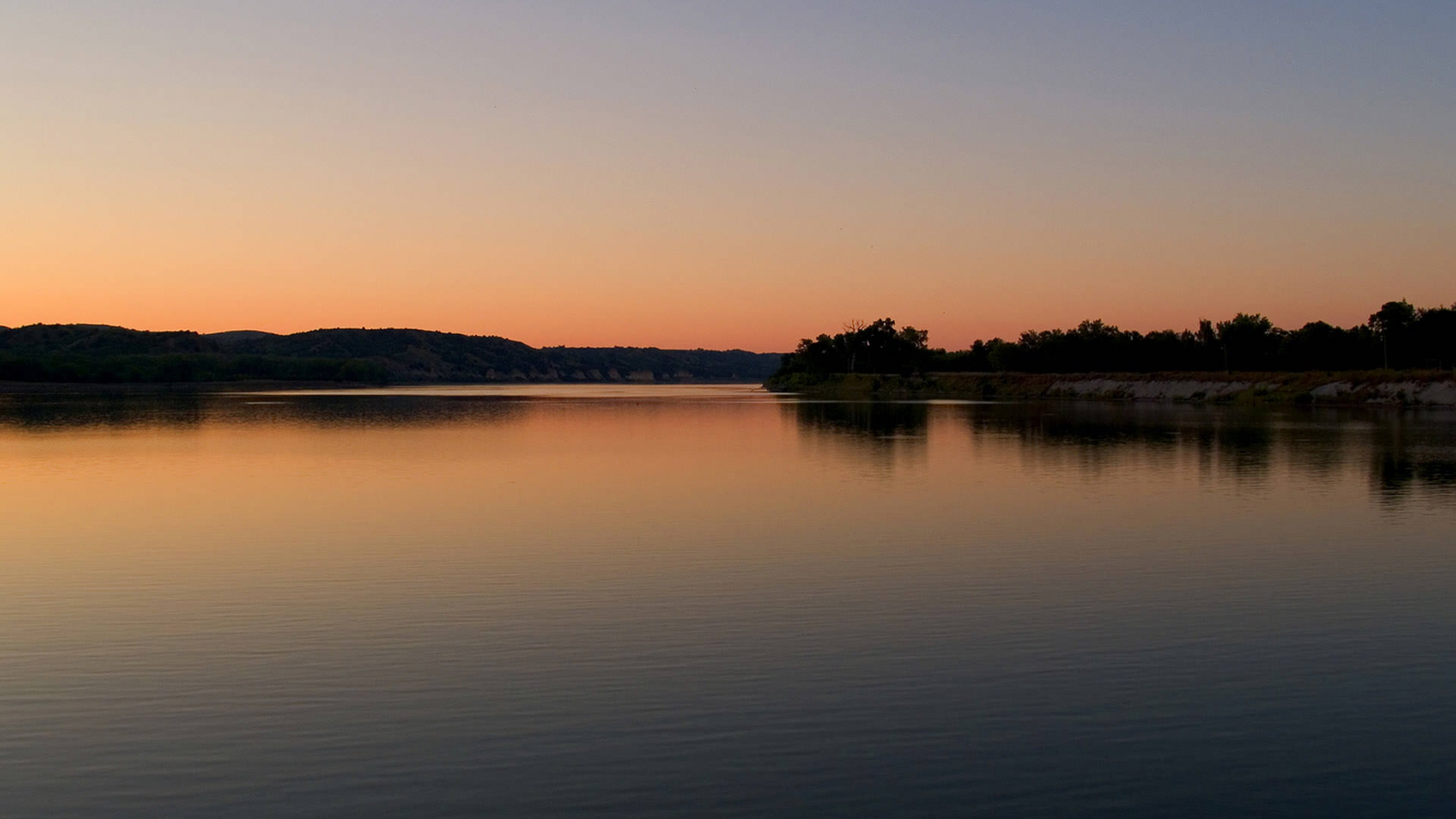 Image of Missouri River with sun setting on water