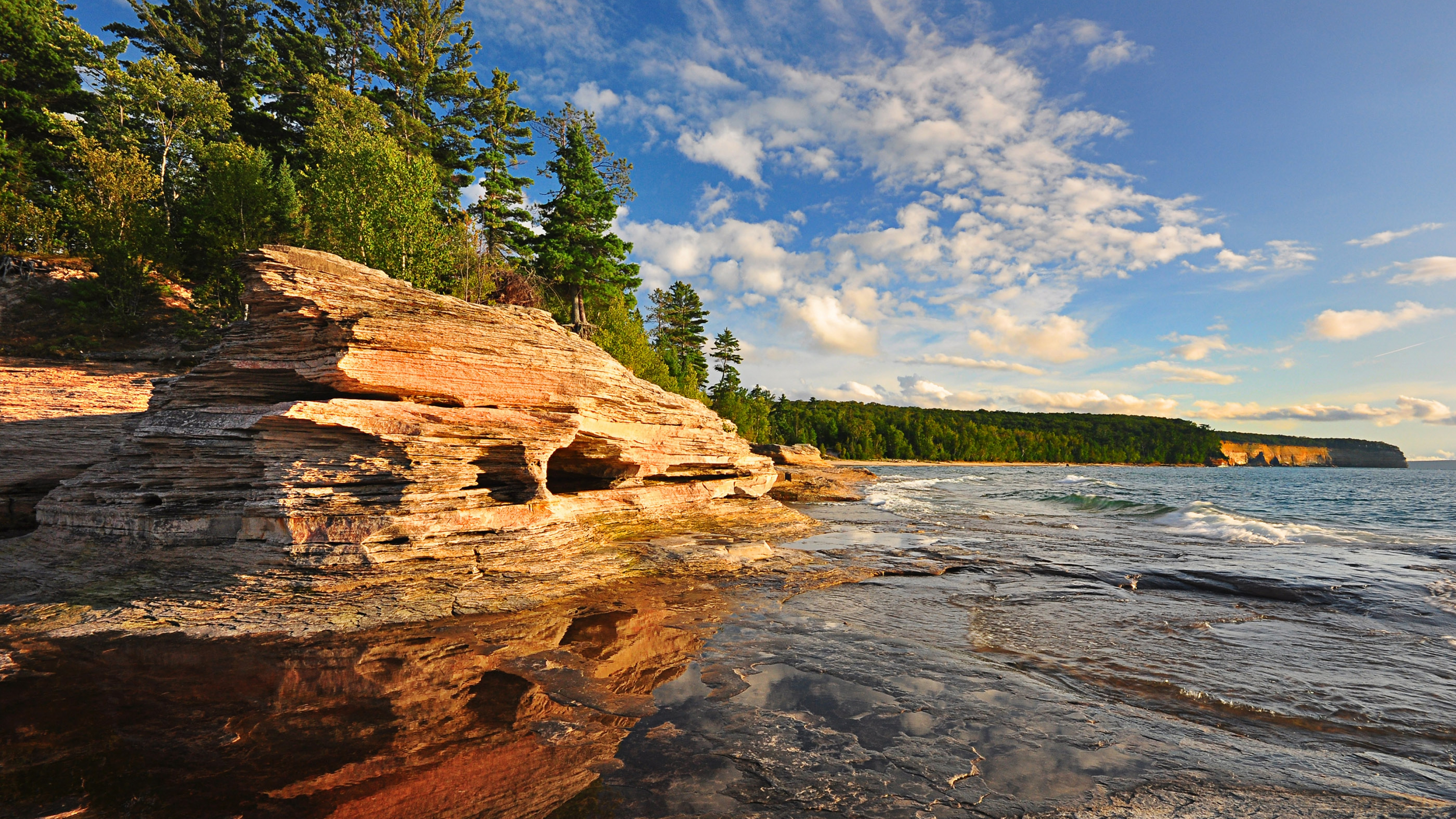 View over the water at the jagged shore of Pictured Rocks