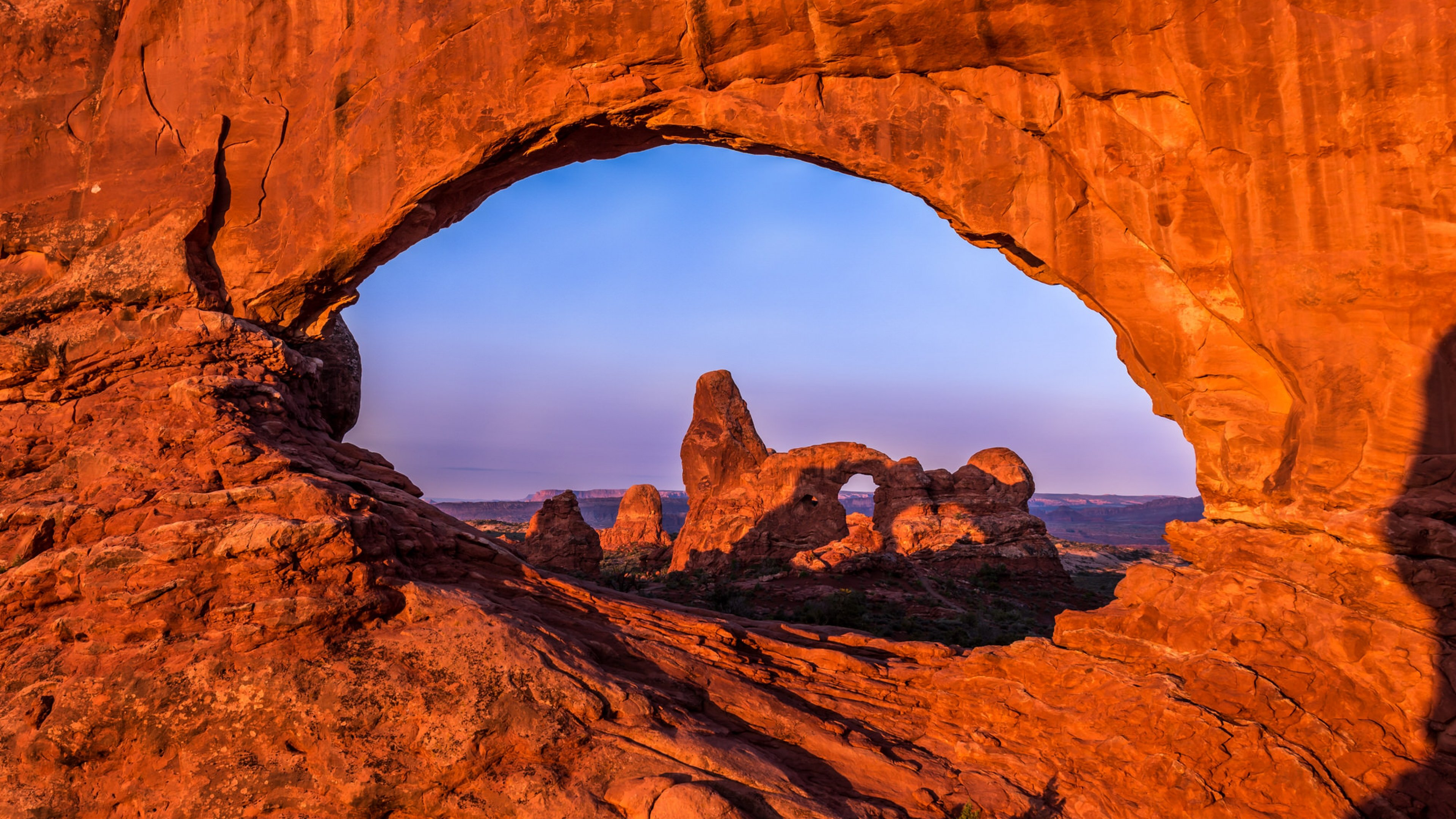 Sunset view of Arches National Park through an archway