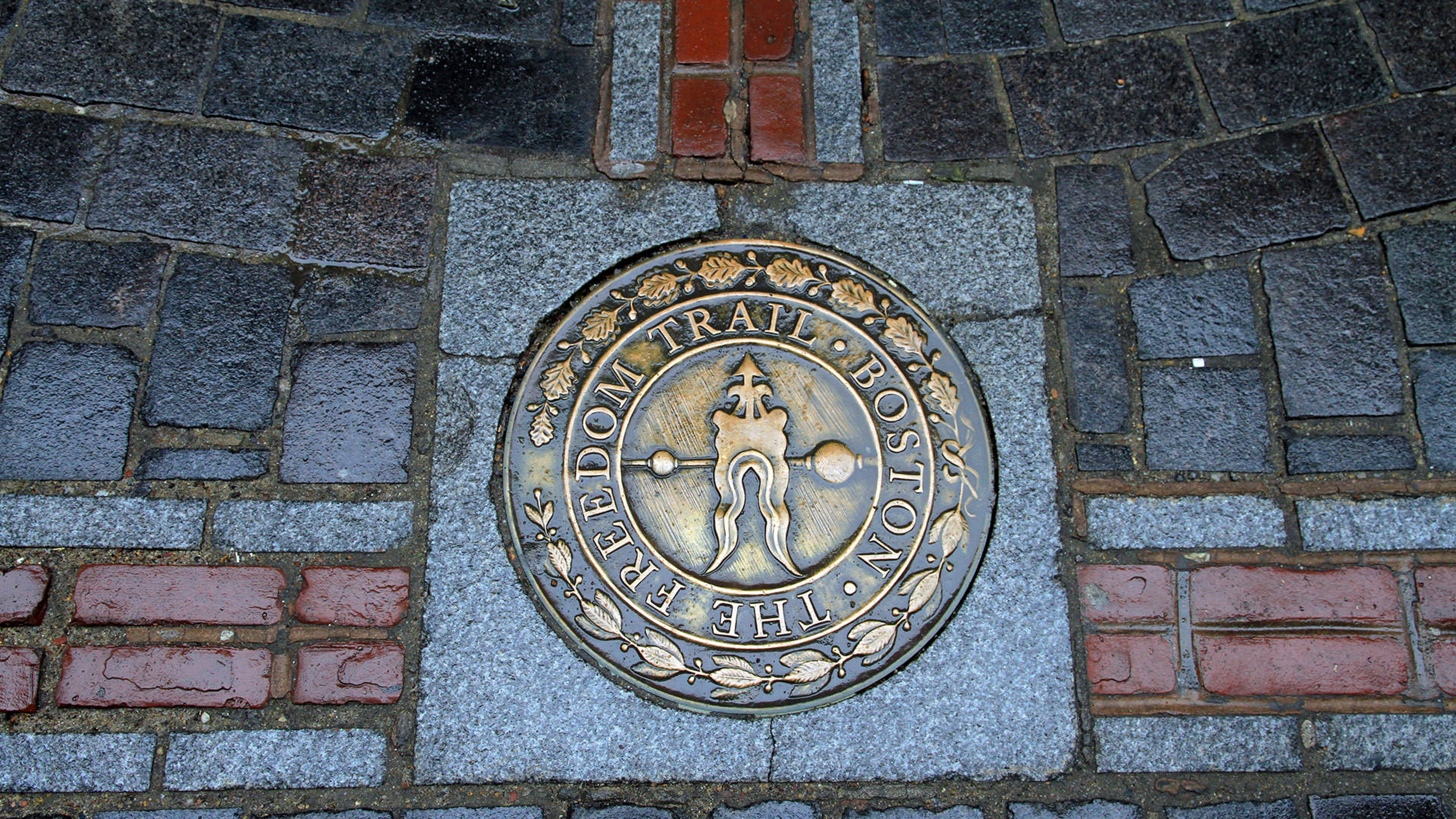 Freedom Trail marker in the sidewalk along the Freedom Trail