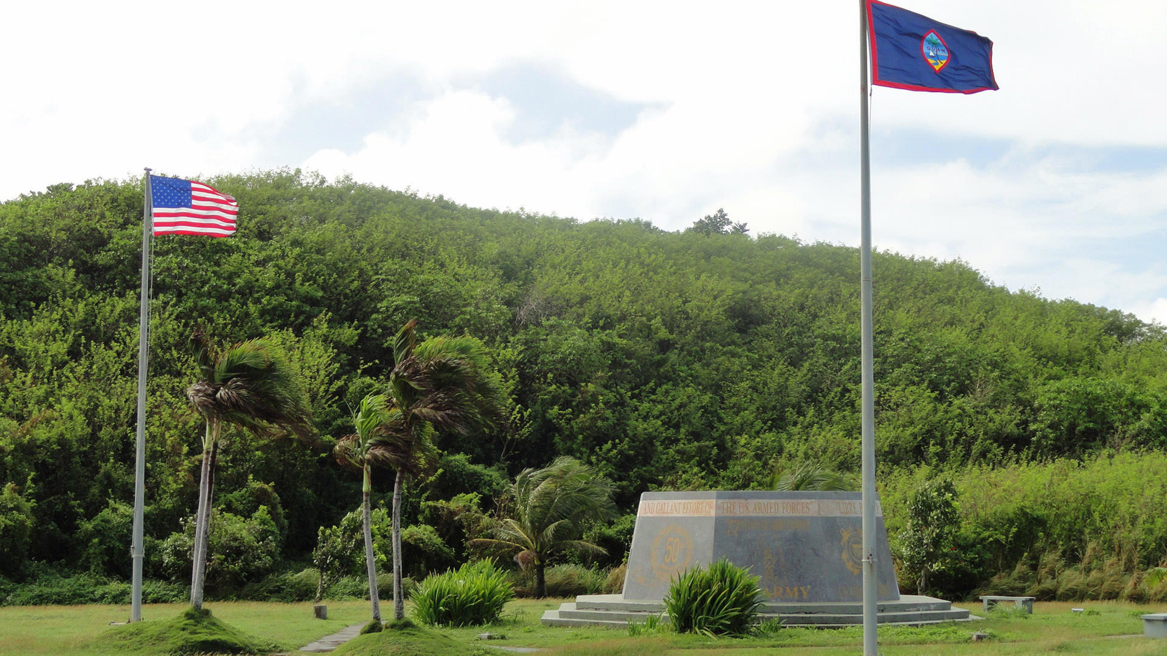 Image of waving flags of World War II Valor in the Pacific National Monument