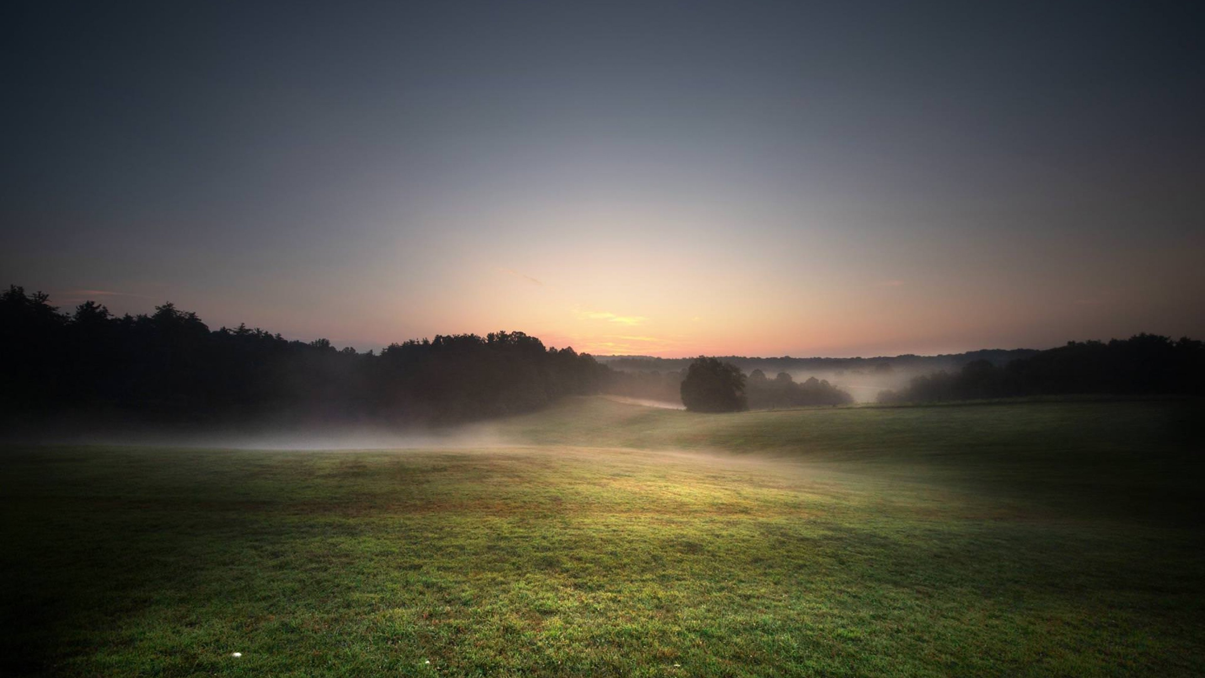 The sun low in the horizon with fog over the pairie at Cuyahoga Valley National Park