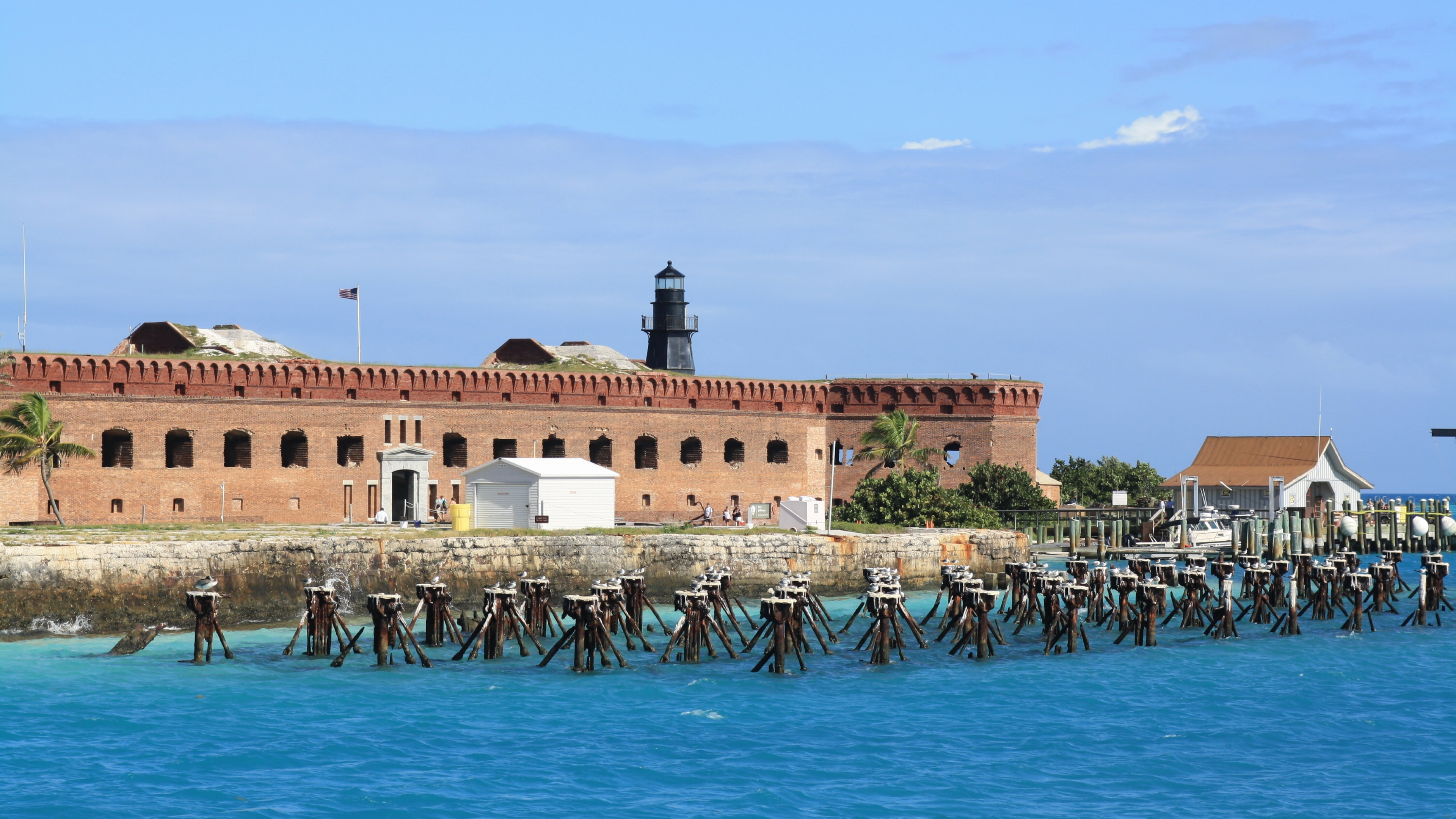 Blue ocean in front of a brick Fort Jefferson at Dry Tortugas National Park, a park in Florida