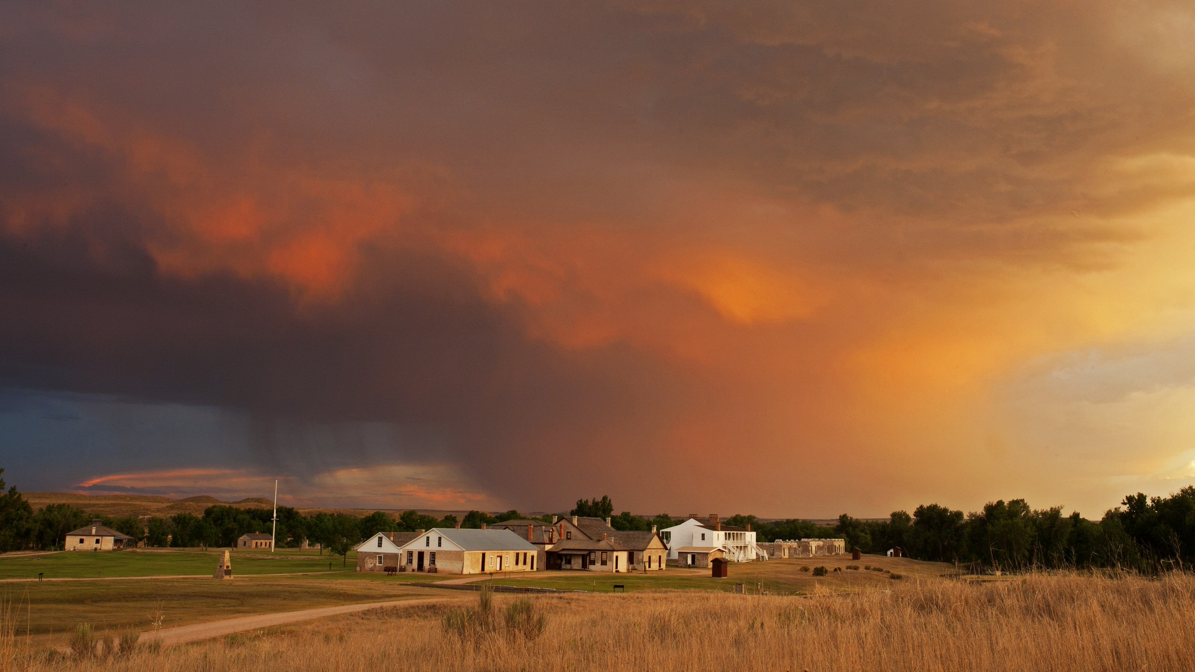 blue, red, and orange clouds at sunset over Fort Laramie National Historic Site