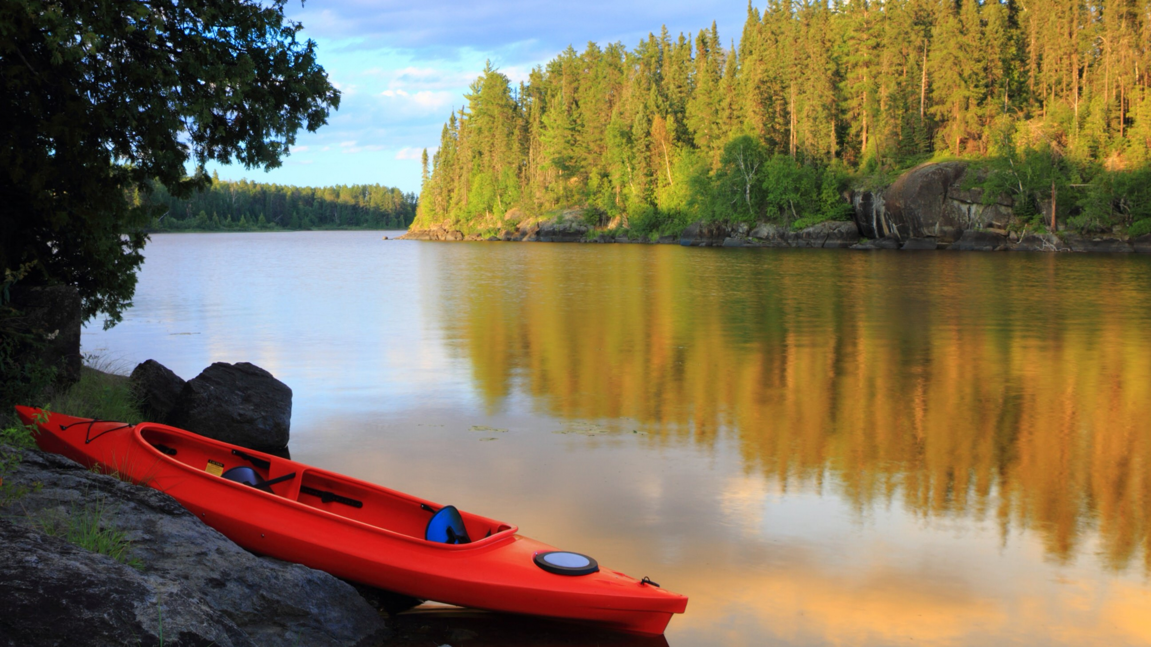 A red canoe on the lake at Voyageurs National Park