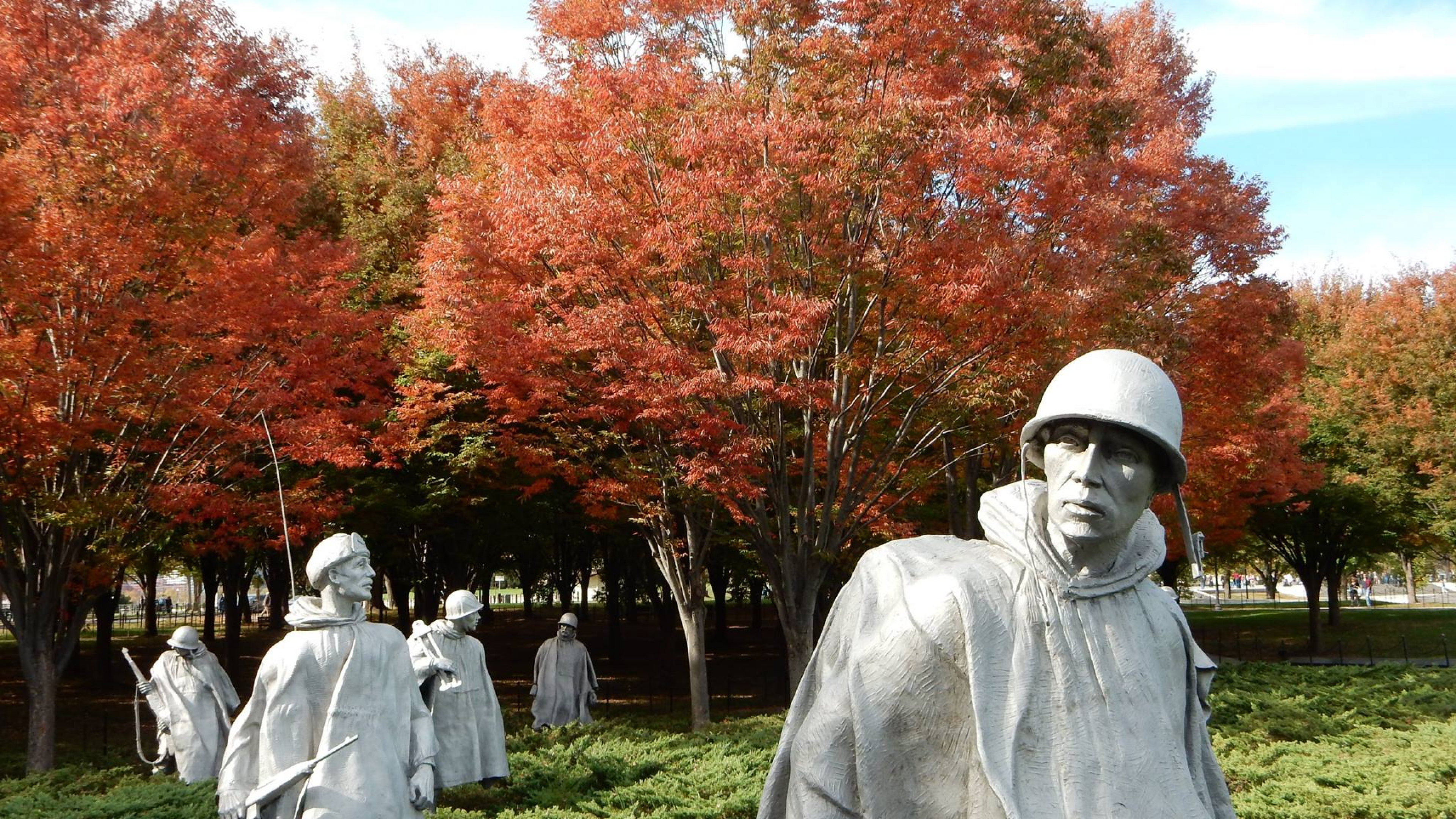 Statues of different types of servicemen from the Korean War in the middle of the Korean War Veterans Memorial in the Fall