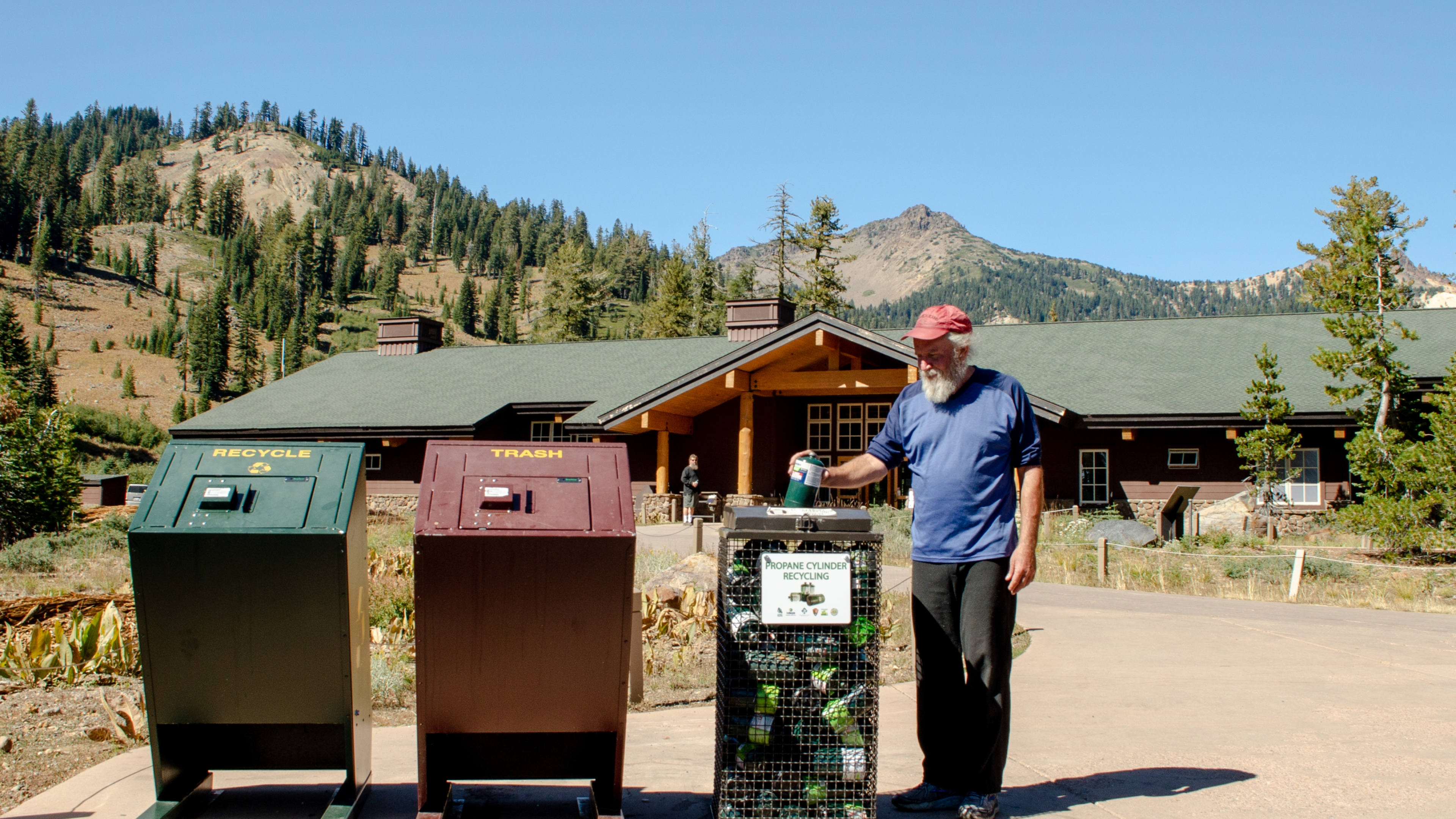 Man utilizing outdoor recycling station at Lassen Volcanic National Park
