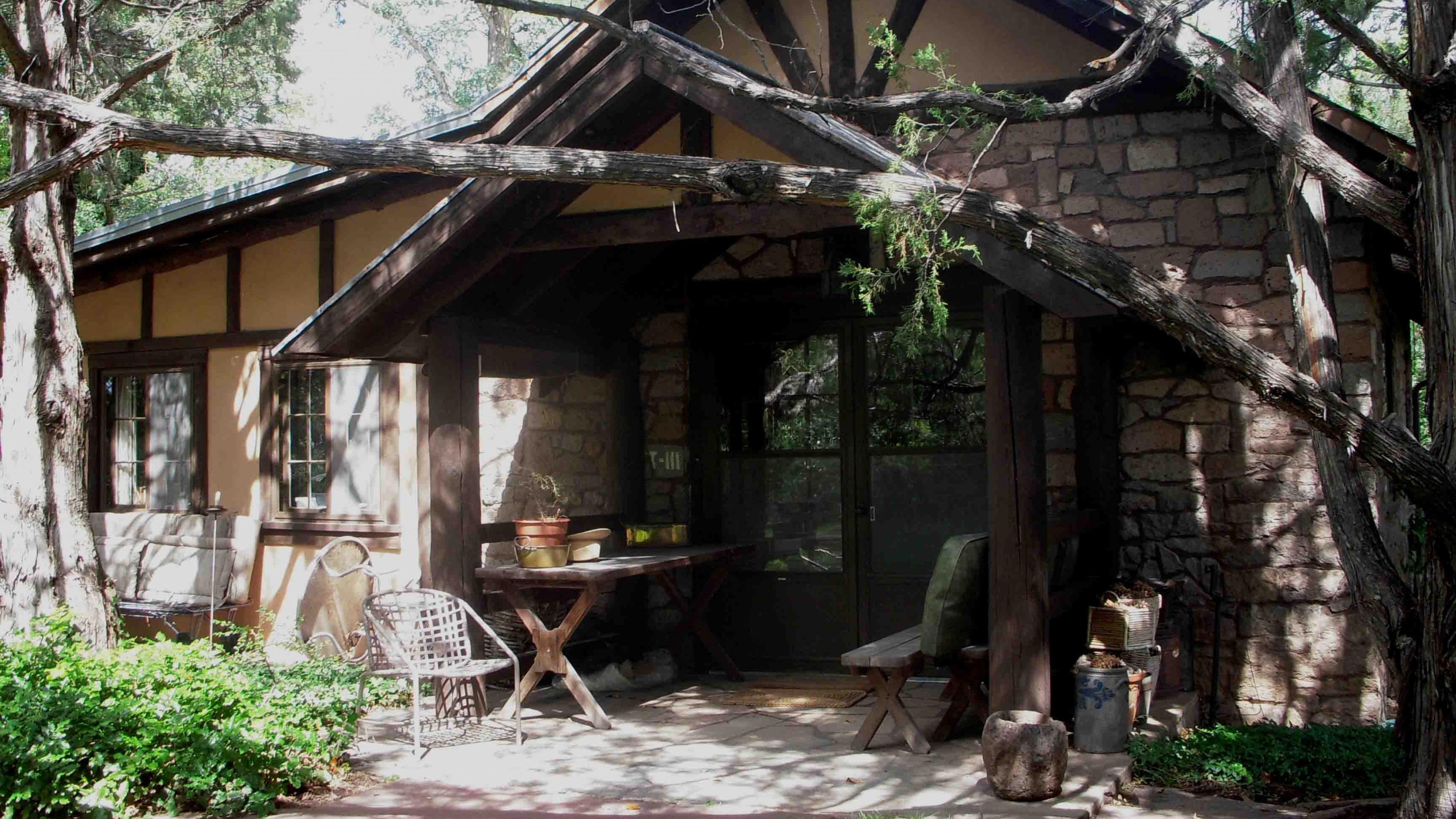 Front entrance of a wood and stone Oppenheimer House at Los Alamos