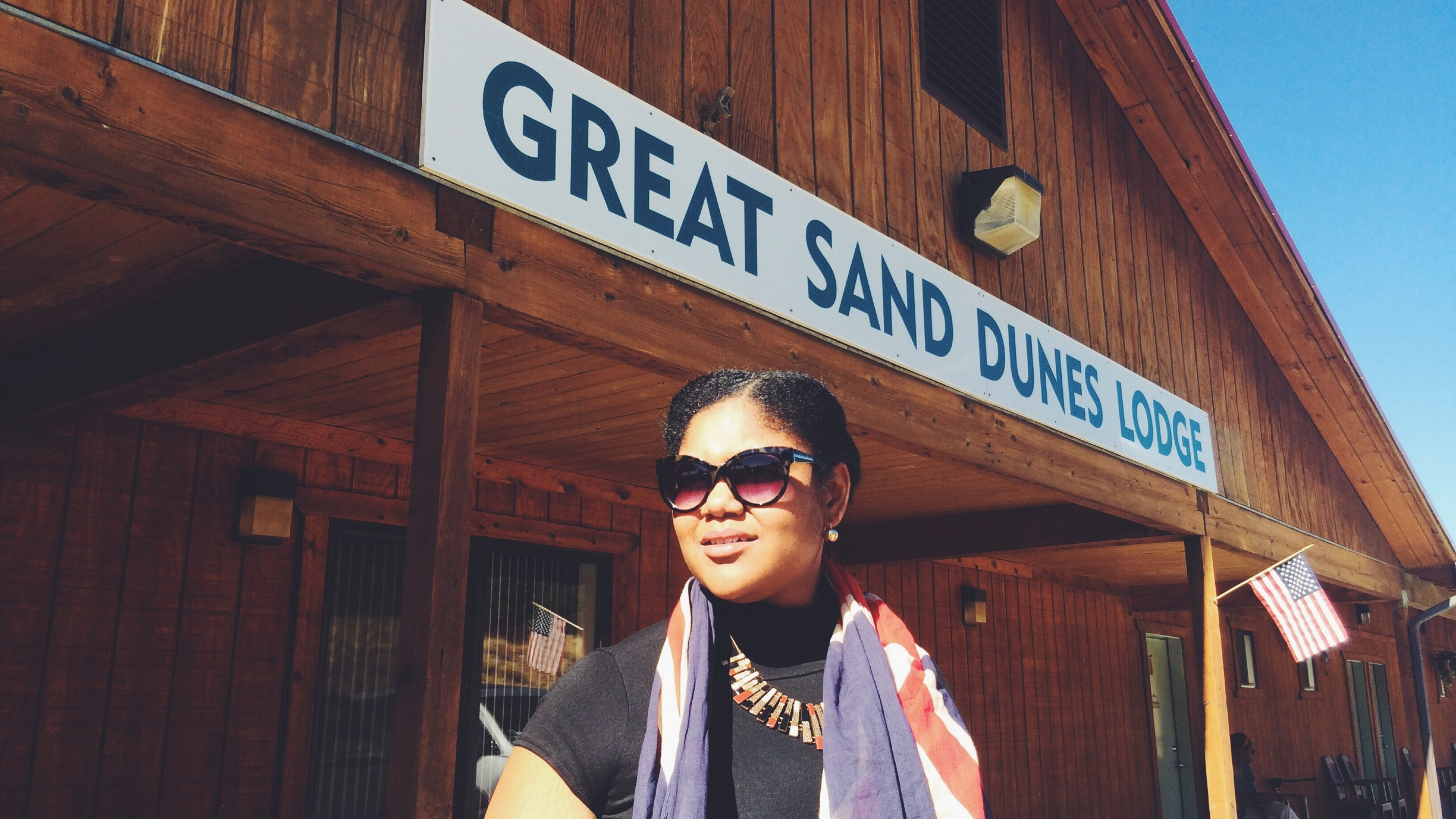 Mellie Davis smiling with Great Sand Dunes sign behind