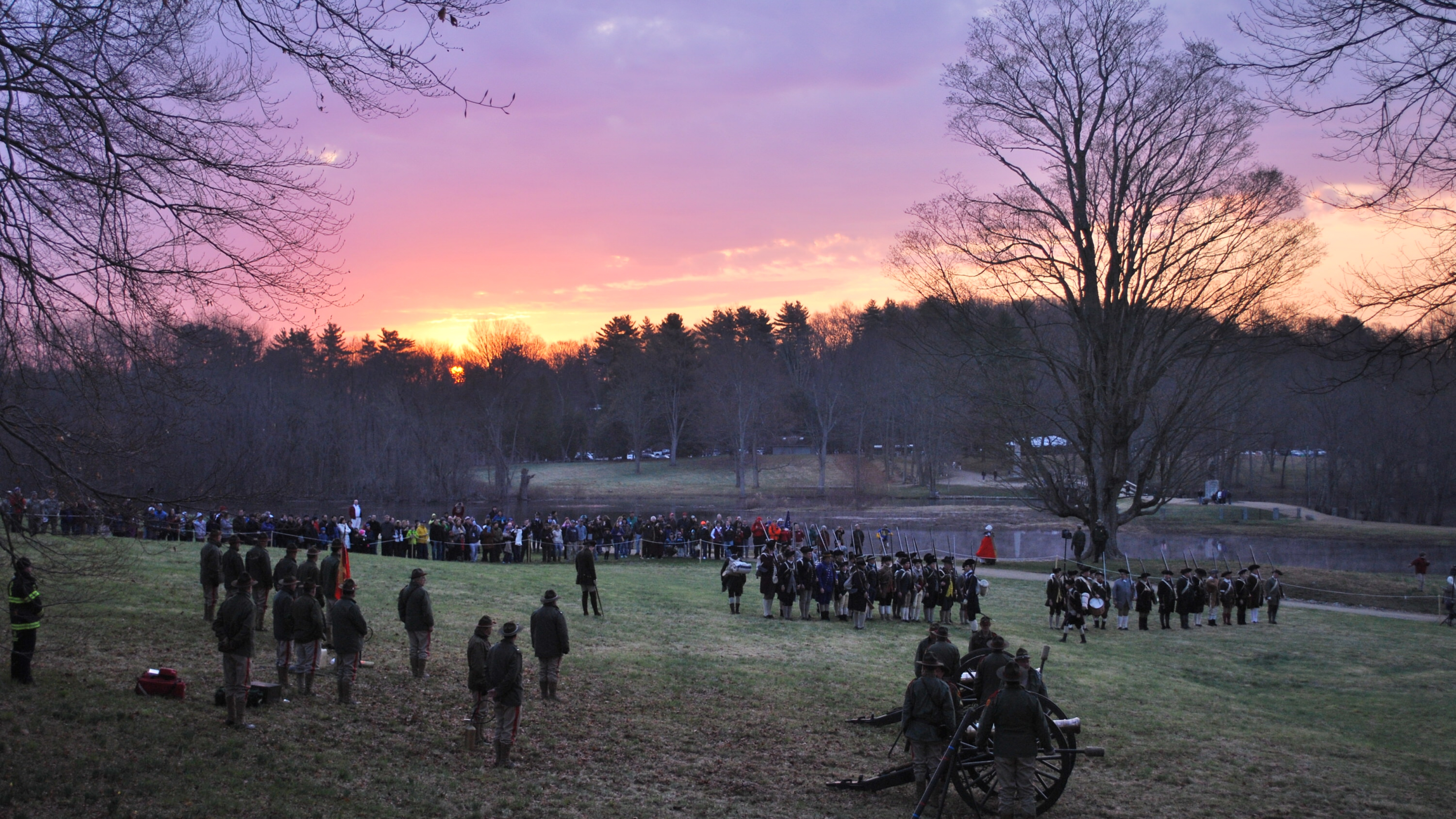 The Concord Independent Battery and Captain Brown's Company stand at attention at dawn at Minute Man National Historical Park