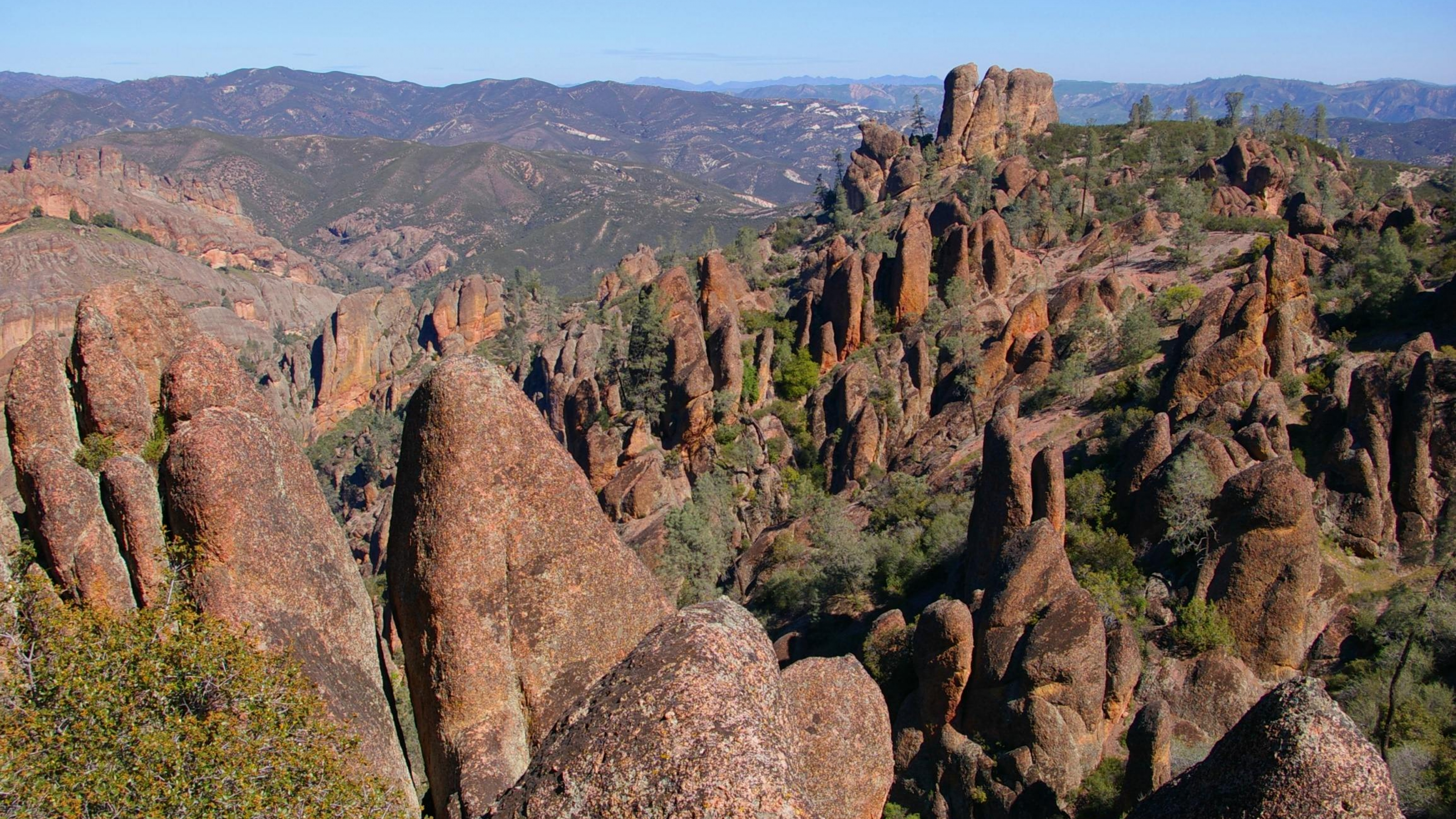 Rock structures across a sweeping view of Pinnacles National Park