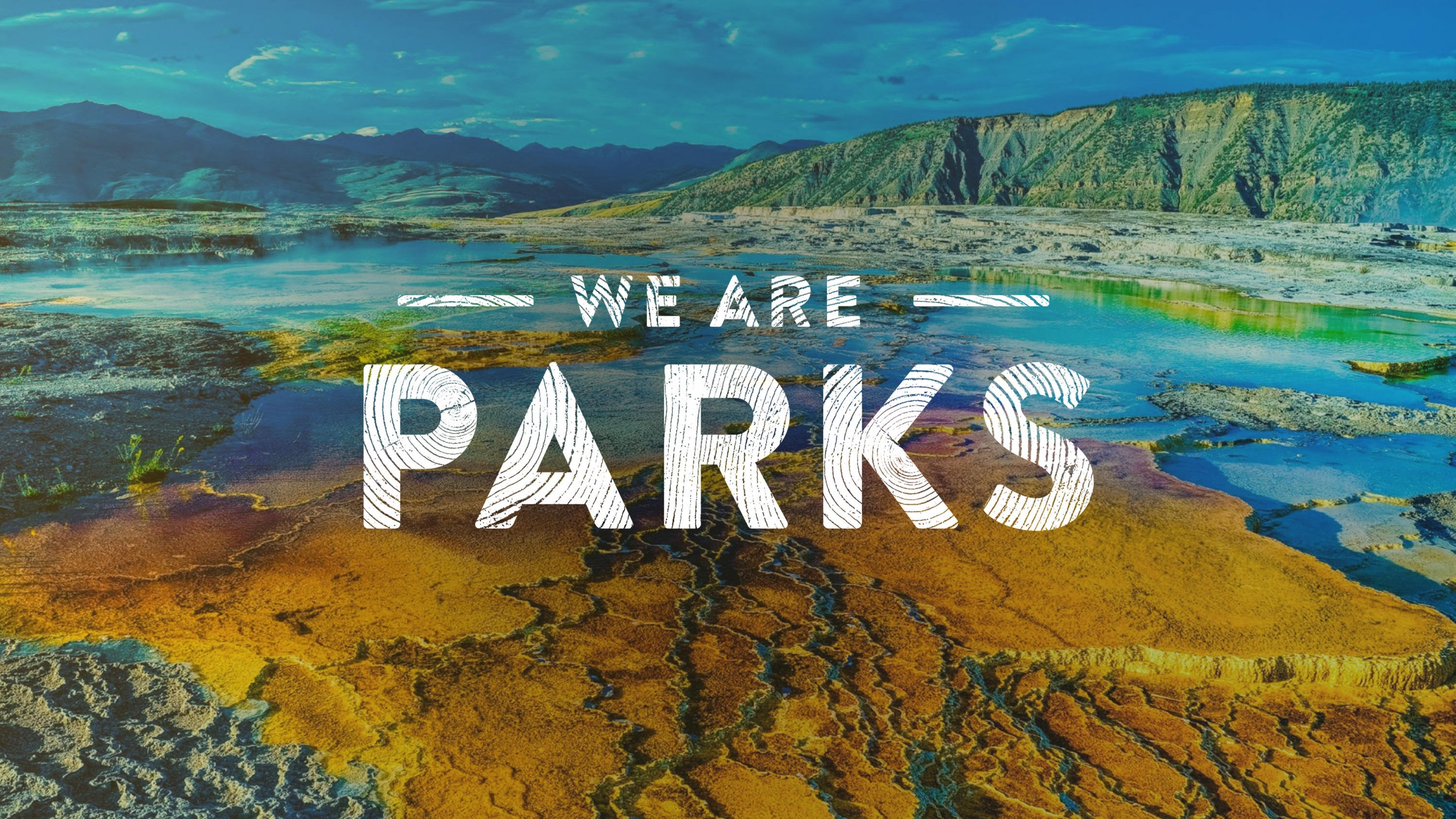 """We Are Parks"" over image of rainbow pool at Yellowstone National Par"