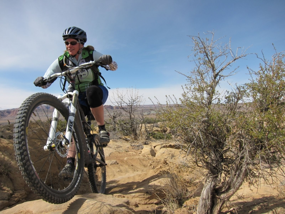 A mountain biker on the Sovereign Trail in Moab Utah