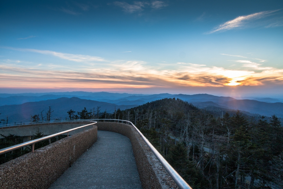 Concrete path overlooking a sunset at the Great Smoky Mountains