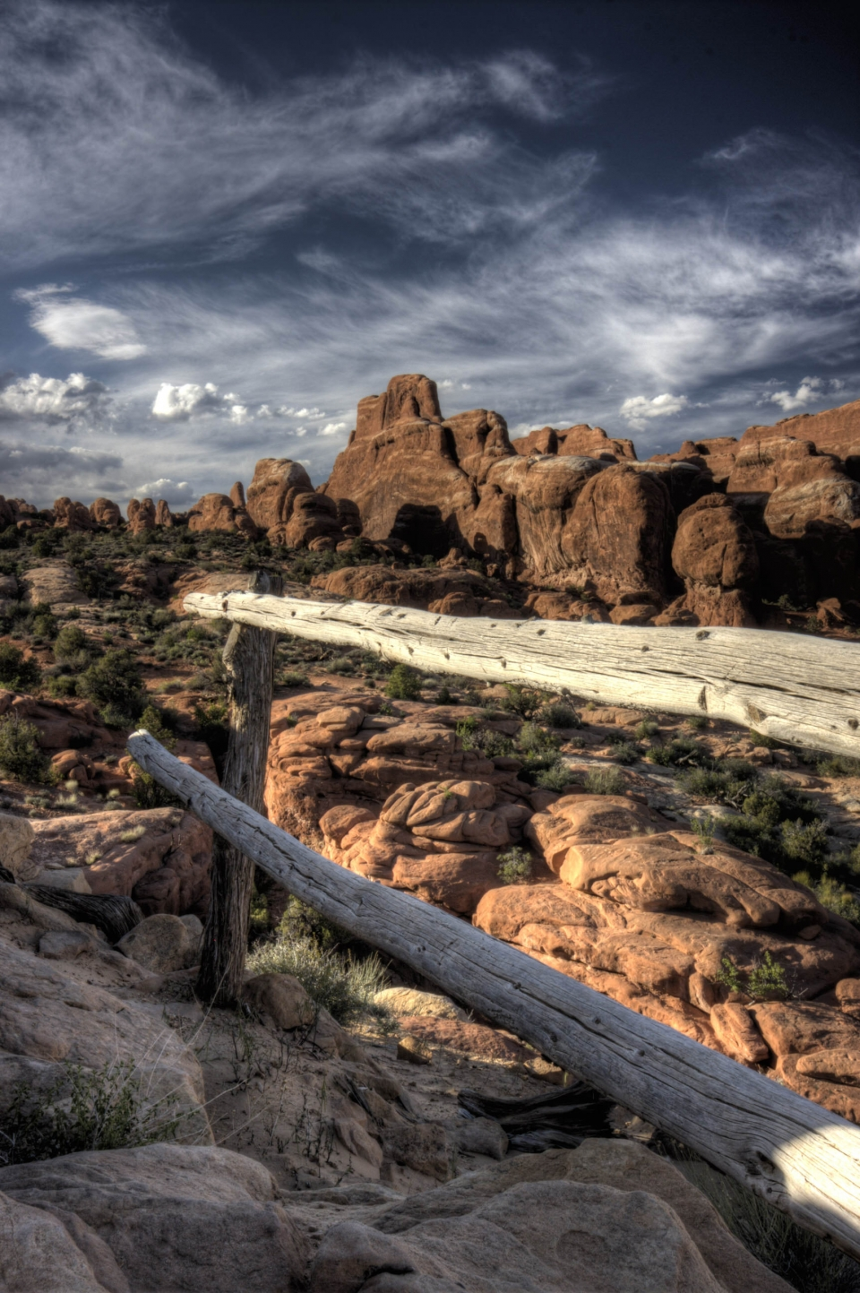 Cloudy, ominous Arches National Park with large rocks