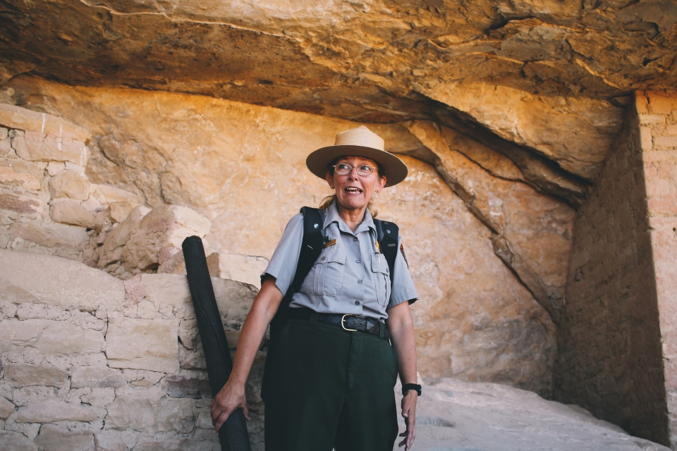 Female park ranger tour guide at the ruins of Mesa Verde National Park