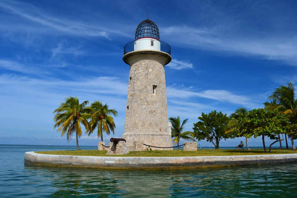 Concrete lighthouse on a small concrete island with a canon in front at Biscayne National Park