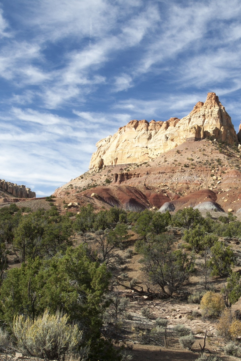 Sunny, blue sky and a view of Capitol Reef Trail