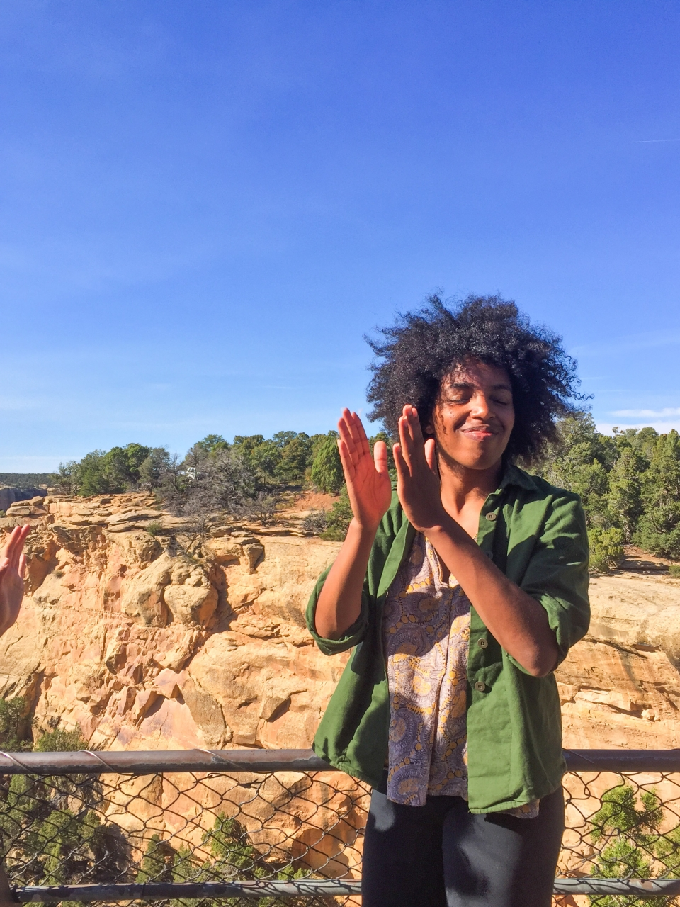 African American woman experiences happiness at Mesa Verde
