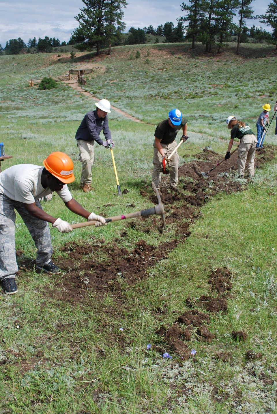 High school students digging and building trails