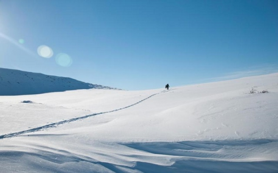 Hiker walking through snow