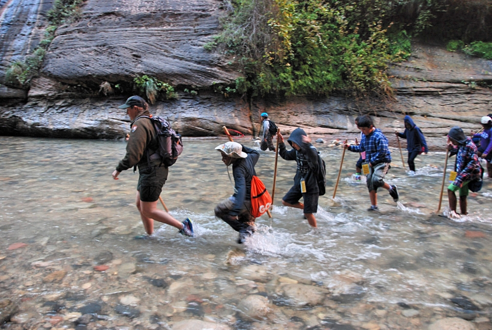 Kids hiking the Narrows at Zion National Park