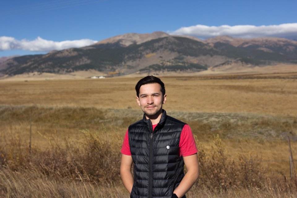 Javier standing with mountain in background