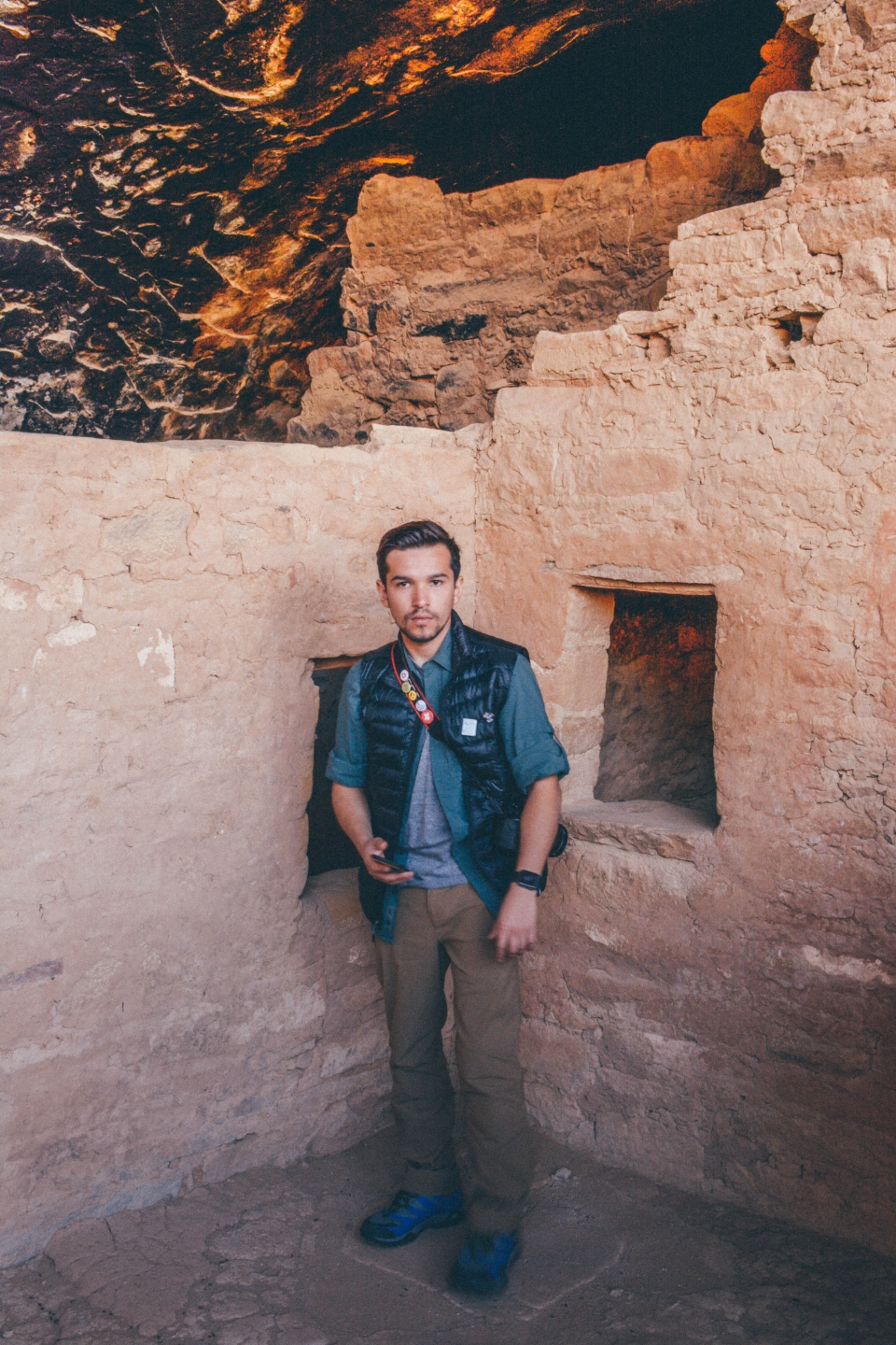 Javier standing in the architectural ruins at Mesa Verde National Park