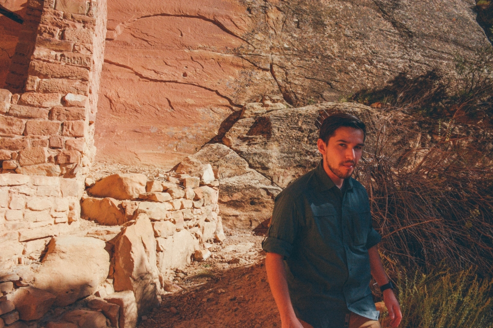 Javier walking through the sandstone cliffs and architecture at Mesa Verde