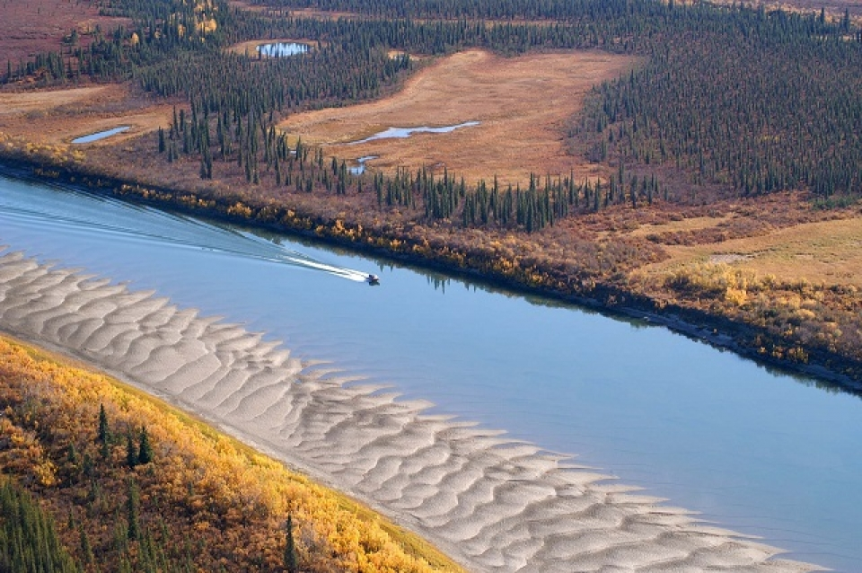 Boat sailing down Kobuk Valley river