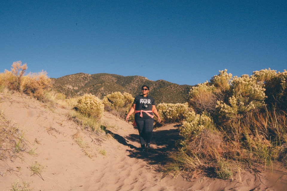 Mellie hiking through Great Sand Dunes National Park and Preserve