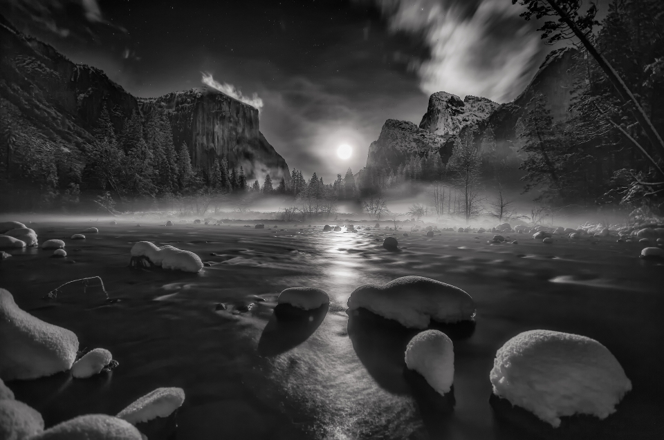 The moon rising in between El Capitan and Cathedral Rocks at Yosemite National Park.