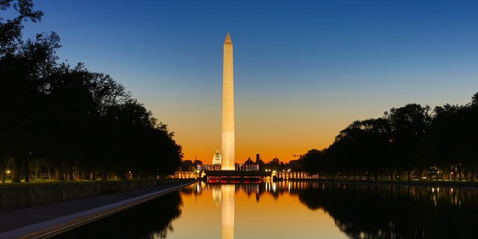 Washington Monument lit up at sunset