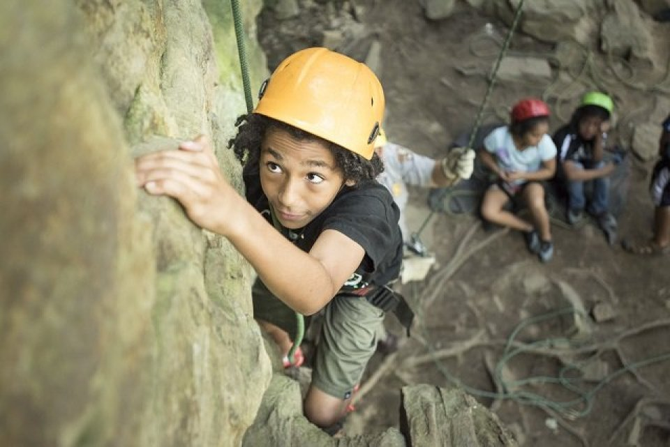 Image of young African American boy rock climbing at Obed National Park