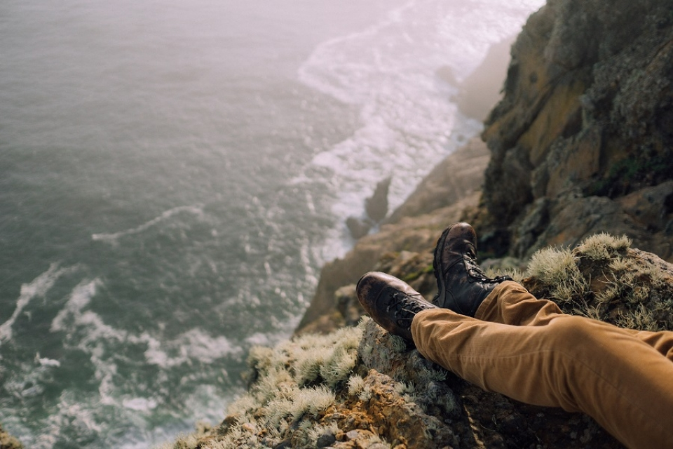 Hiking boots at the edge of a on a cliff at Point Reyes National Seashore