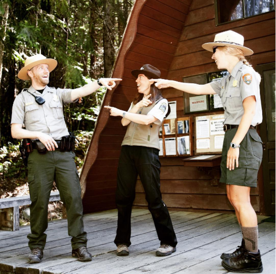 National Park Service park rangers pointing at things